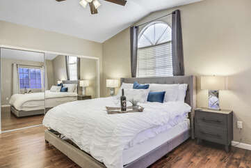 Master Suite 1 is located on the second floor at the end of the hallway and features a King-sized Bed, 28-inch TCL with Roku Smart television.
