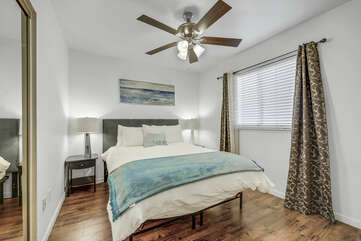 Bedroom 3 is located on the second floor across from Bedroom 2 and features a Queen-sized Bed, a 43-inch TCL with Roku Smart television, switch-controlled ceiling fan, and reach-in closet.