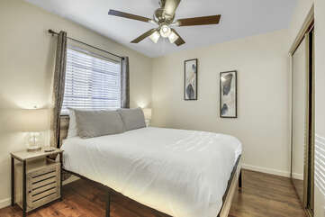 Bedroom 4 is located on the second floor next to Master Suite 1 and features a Queen-sized bed, a 43-inch TCL with Roku Smart television, switch-controlled ceiling fan, and reach-in closet.
