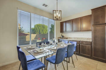 The casual dining area features a dining table with seating for eight.