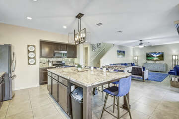 The fully-equipped kitchen features stunning stainless steel appliances.