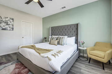 Master Suite 1 features a King-sized Bed, 32-inch Samsung Smart television, switch-controlled ceiling fan, and large walk-in closet.