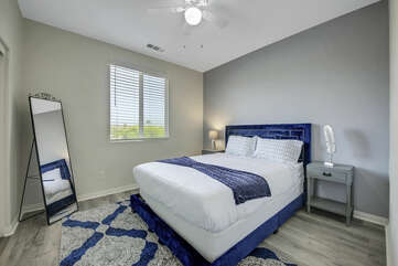 Bedroom 2 is located next to Master Suite 1 and features a Queen-sized Bed, switch-controlled ceiling fan.