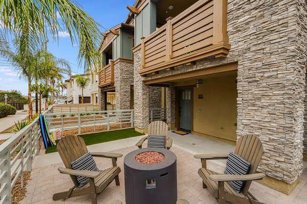 Inviting Ground Floor Patio w/ Fire Pit, Seating, & Peek-A-Boo Bay Views