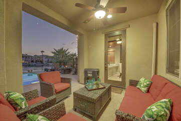 Enjoy some sparkling conversation on the comfortable patio furniture under the switch controlled ceiling fan with room for seven.