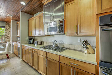 The fully-equipped kitchen features stunning stainless steel appliances such as a GE french door refrigerator with a water and ice dispenser and offers everything one would need to create their perfect meal.