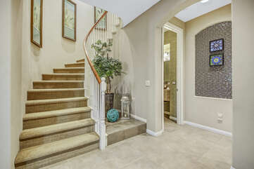 The stairs that lead up to two spacious rooms and more!