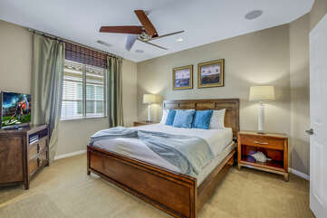 Suite 2 is located upstairs, next to the laundry room and features a King-sized Bed, a 32-inch JVC Smart television.