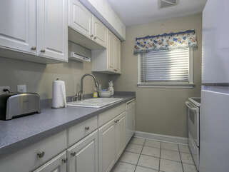 White cabinets line this kitchen