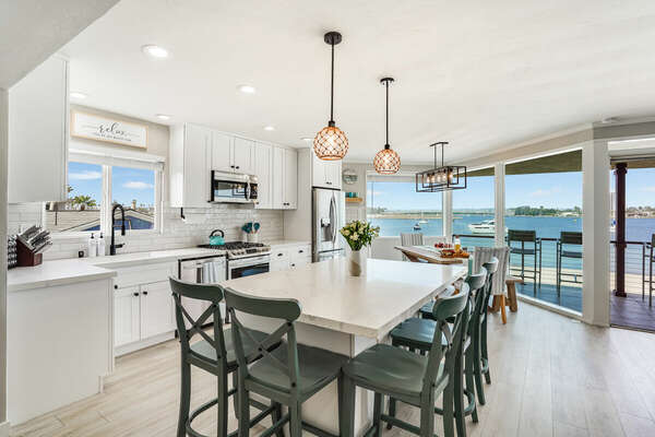 Fully Equipped Kitchen w/ Island Seating & Bay Views