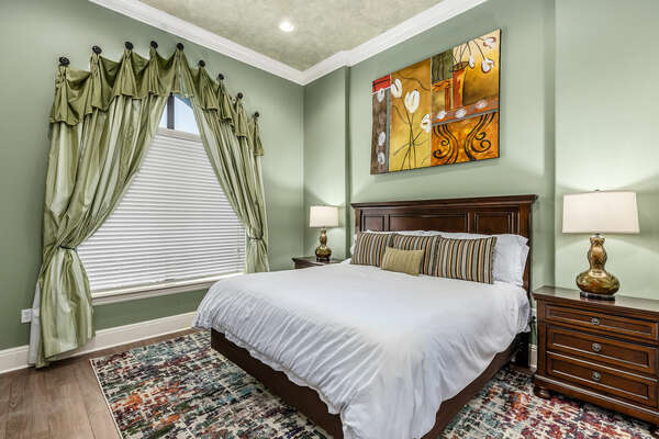 This bedroom is perfect for relaxation with a comfortable king bed.