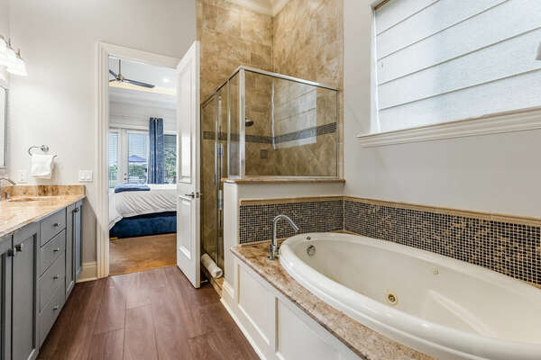 This bedroom comes with a private bathtub.
