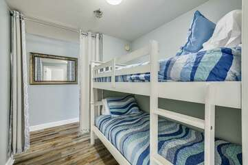Bunk bed area with curtain partition.