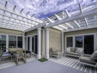 The pergola terraced porches offer dining and seating with views of the 18th green.