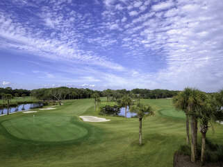 Enjoy stunning views of the 18th hole on Ocean Winds golf course.