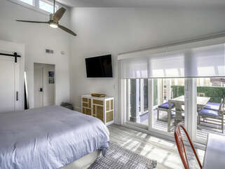 Master Bedroom has sliders leading out to the deck. Transom windows, vaulted ceilings and fans.