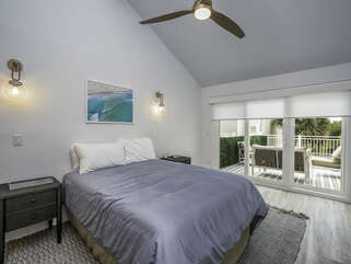 The guest bedroom has sliders leading out to the porch.