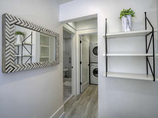 A  full size stacked washer and dryer is in the laundry closet off the guest bathroom