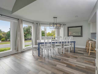 The dining room has floor to ceiling windows