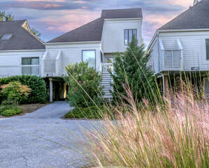 Welcome to 723 Spinnaker Beach House. A stunning renovated 2 bedroom, 2 bath villa.  Just steps from a beach boardwalk.
