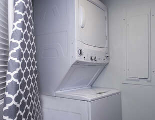 Stacked washer/dryer is in the first floor laundry closet